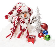 Snowman. And christmas gift Royalty Free Stock Photos