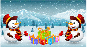 Snowman with christmas gift Royalty Free Stock Images