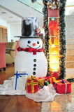 Snowman and Christmas gifts Royalty Free Stock Images