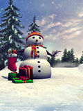 Snowman with Christmas gifts Royalty Free Stock Photography