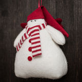 Snowman Christmas handmade toy. Hand made felt  snowman Christmas decoration. Christmas toy. Vintage style, over wood background Royalty Free Stock Images