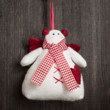 Snowman Christmas handmade toy. Hand made felt  snowman Christmas decoration. Christmas toy. Vintage style, over wood background Stock Photo