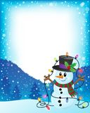Snowman with Christmas lights frame 1 Stock Photography