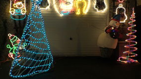 Snowman and Christmas lights outside at night stock video