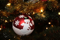 Snowman christmas ornament round shiny. Ball ornament in christmas tree snowman and snowflakes Stock Photography