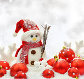 Snowman and Christmas ornaments Royalty Free Stock Image