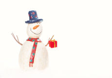 Snowman with a Christmas present Royalty Free Stock Photos