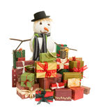 Snowman and christmas presents. Large snowman surrounded by colorful christmas presents stock photography