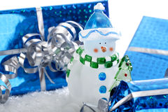 Snowman with Christmas presents Royalty Free Stock Image
