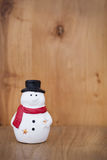Snowman christmas toy on wooden background. Xmas Stock Photos