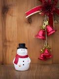 Snowman christmas toy on wooden background. Xmas Stock Photo