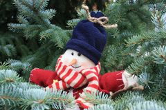 Snowman in a Christmas tree Royalty Free Stock Photos