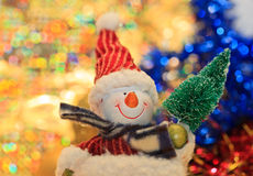 Snowman with christmas tree royalty free stock images
