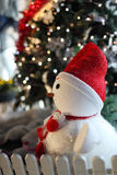 Snowman with christmas tree Stock Photos