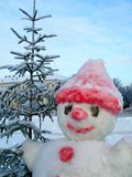 The snowman with a christmas-tree . The snowman with a christmas-tree welcomes visitors Royalty Free Stock Photography