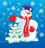 Snowman and Christmas tree Royalty Free Stock Photos