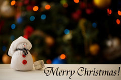 Snowman on a Christmas tree background with inscription Royalty Free Stock Images