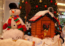 Snowman and Christmas tree. Royalty Free Stock Image