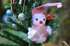 Snowman on the Christmas tree with decorations on special days.  stock image