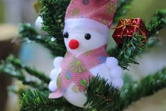 Snowman on the Christmas tree with decorations on special days.  stock photo