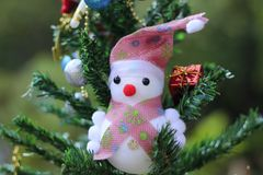 Snowman on the Christmas tree with decorations on special days.  stock images