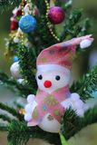 Snowman on the Christmas tree with decorations on special days.  royalty free stock photography