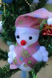 Snowman on the Christmas tree with decorations on special days.  royalty free stock images