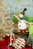 Snowman with christmas tree Royalty Free Stock Image