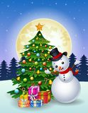 Snowman with christmas tree and gift boxes at night full moon background Stock Image