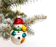Snowman on Christmas tree Stock Images