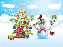 Snowman with Christmas Tree. Happy snowman with decorated Christmas tree, snowy winter scene Stock Images