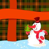 Snowman with Christmas tree near a big present Stock Photos