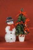 Snowman and Christmas Tree Scene Stock Photography