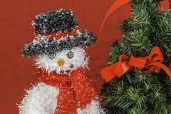 Snowman and Christmas Tree Scene Royalty Free Stock Photos