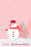Snowman christmas tree snowflakes and the german words for Merry Christmas Royalty Free Stock Photography