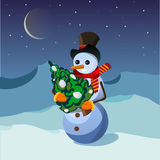 Snowman with Christmas tree. In the snowy mountains Royalty Free Stock Photo
