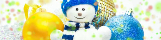 Snowman, christmass balls and colorful confetti stock photo