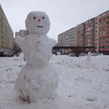 Snowman in the city Stock Images