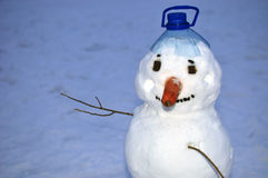 Snowman cobbled together in winter Royalty Free Stock Images