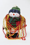 Snowman with colored necklaces Stock Photos