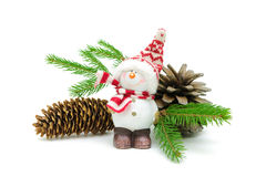 Snowman, cones and spruce twigs on a white background Stock Image