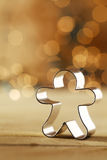 Snowman cookie cutter with a sparkling bokeh Royalty Free Stock Images
