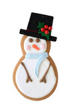 Snowman cookie isolated on white. Frosty the Snowman gingerbread cookie isolated on white background in vertical format Royalty Free Stock Image