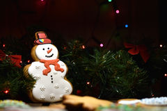 Snowman cookie. New year and christmas cookie on dark background, low key, stylish Royalty Free Stock Photo