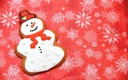 Snowman cookie on red background. Flat, horizontal free space snowman photo. White Royalty Free Stock Photo