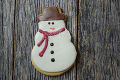 Snowman Cookie on Rustic Wood Background Royalty Free Stock Photography