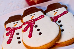 Snowman Cookies. 3 decorated snowman sugar cookies sitting on white plate Royalty Free Stock Photo