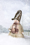 Snowman. In country lane with snow falling Royalty Free Stock Image