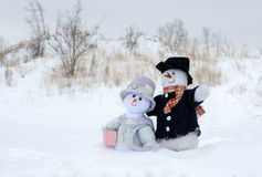 Snowman couple at the beach royalty free stock photos