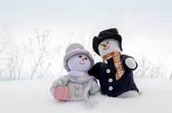 Snowman couple  cuddle in the snow Stock Images